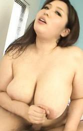 Milf Asian Office Lady - Yume Sazanami Asian rubs cock of her big jugs and sucks it well