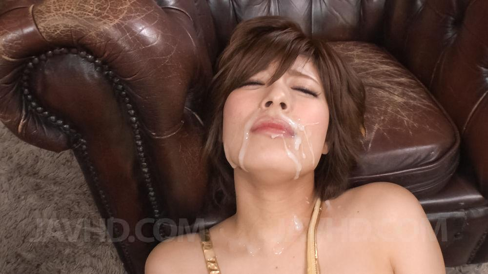 Cumshot on asian milfs face
